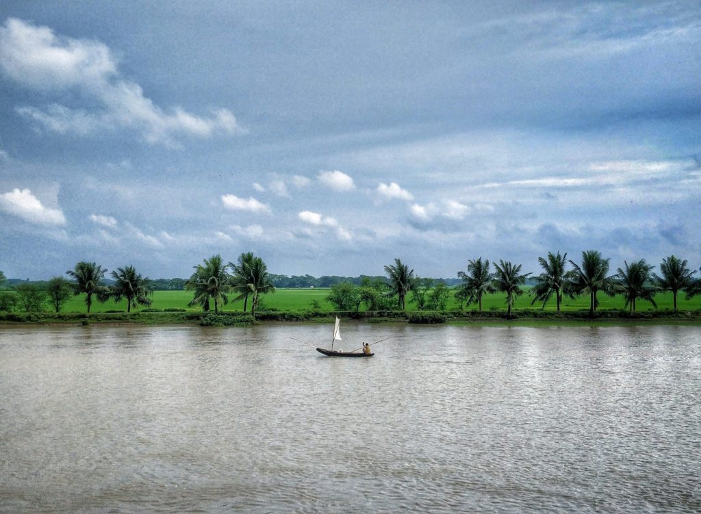 view of Bangladeshi village from river cruise in Sundarban